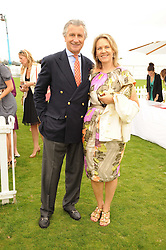 ARNAUD & CARLA BAMBERGER at the Cartier International Polo at Guards Polo Club, Windsor Great Park, Berkshire on 25th July 2010.