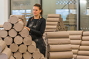 Student Flor Mendschein collects some more raw clay - FACTORY: the seen and the unseen - an installation, in the form of a ceramics factory, by artist Clare Twomey. It is set up in the Blavatnik Building of the Tate Modern and launches the second year of Tate Exchange which, over 2017 and 2018, will focus on the theme of production.