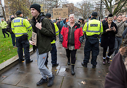 © Licensed to London News Pictures; 14/11/2020; Bristol, UK. People walk through a police line unopposed at the start of an Anti-Lockdown protest march and rally by Stand Up Bristol and StandUpX2, against the Covid-19 lockdown during the coronavirus pandemic, takes place on College Green in front of Bristol City Hall. Protests have been declared illegal under the current Covid-19 lockdown as people are not allowed to meet in more than groups of two and police have threatened arrests and fines against those attending. Police arrested several people. The protest is against Lockdowns, Isolation of the Elderly, Ruined Childhoods, Business Closures, Masks, Government Interference in Private Life and is part of a series of protests today in Sheffield, Wolverhampton, Portsmouth, Bristol and Bournemouth. England is under a national lockdown, sometimes known as lockdown 2.0, as the UK Government tries to stop the spread of the covid-19 coronavirus pandemic. From 05 November lockdown restrictions came into force across England with all pubs, bars, restaurants and entertainment venues shut as well as all non-essential shops. People have been told to stay at home except for work, education, exercise or essential shopping and each person can only meet one other person from outside their household in an outdoors public space. Photo credit: Simon Chapman/LNP.