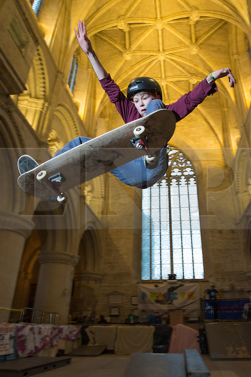 """© Licensed to London News Pictures 15/02/2017, Malmesbury, UK. The """"Malmesbury Abbey Skate"""" now in its's 9th year, where the interior of the 12th century abbey in Malmesbury, Wiltshire is turned into a skate park for 3 days during the February half term. Pictured here: 14 year old Sam Vugts getting """"some air"""".<br /> Photo Credit : Stephen Shepherd/LNP"""
