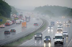 © Licensed to London News Pictures 17/06/2021. Swanley, UK. Torrential rain is causing poor visibility for drivers on the M25 in Kent near Swanley this afternoon. Photo credit:Grant Falvey/LNP