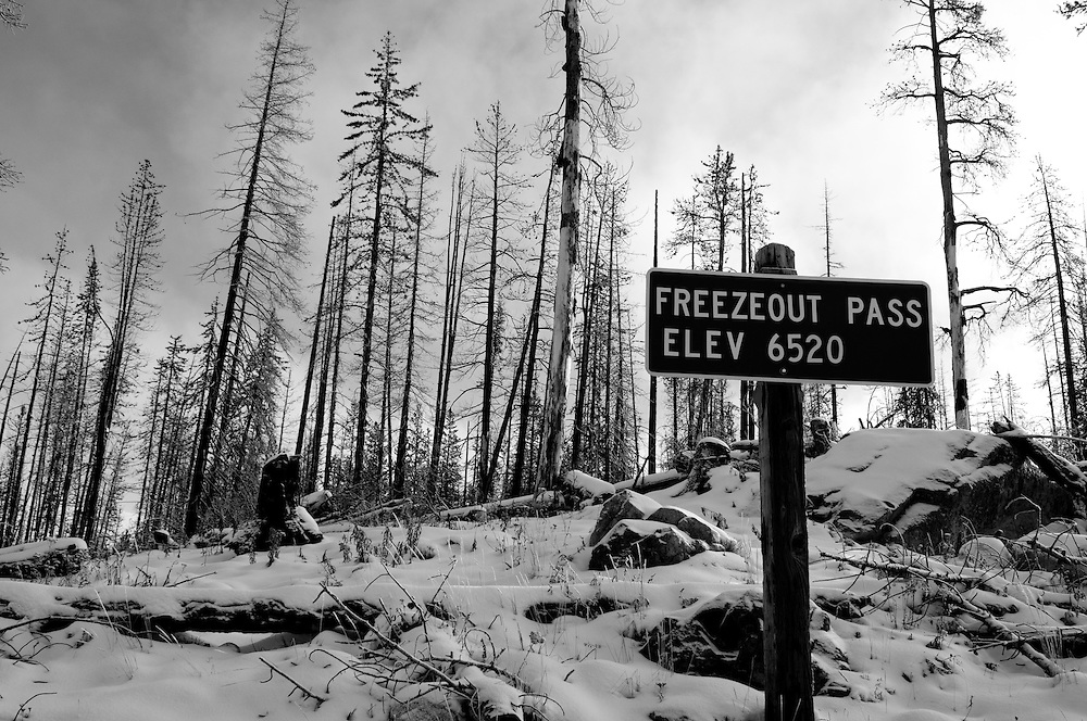 Freezeout pass sign with the 2006 Tripod Fire evident in the background.