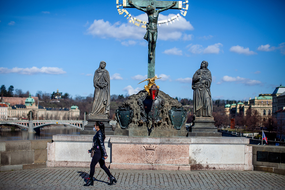 A young lady with face mask on Charles Bridge. On March 1st, 2021 the state of emergency in the Czech Republic was reinstalled because of fast increasing numbers in infections. The lockdown was reinstated and the restriction of the free movement of people has taken effect. Currently, the country remains at the highest stage of the anti-epidemiological system and the newly imposed restriction will last at least three weeks to curb the epidemic.