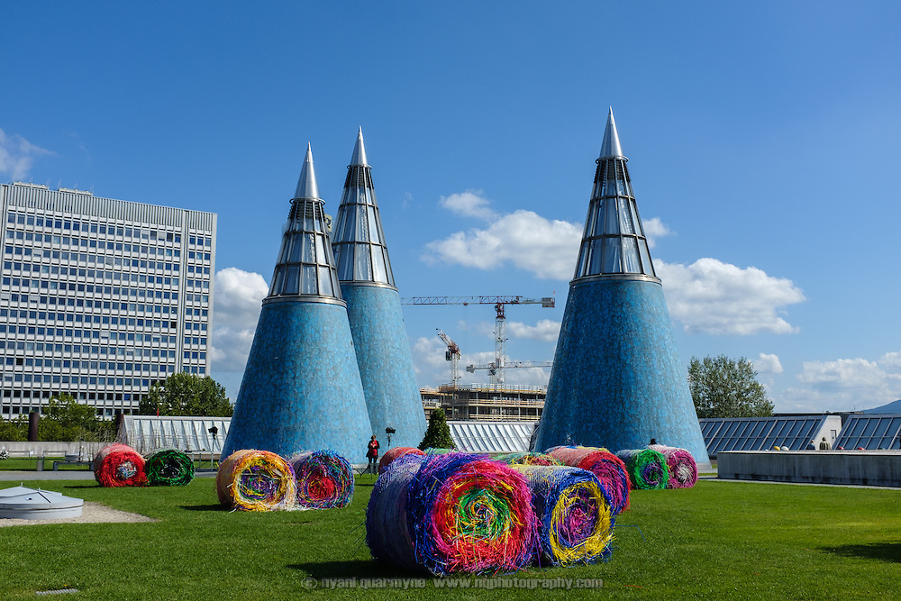"""Michael Beutler's """"Bale Harvest"""" aginst the backdrop of the cones on the roof of the Bundeskunsthalle museum as part of an exhibition entitled """"Trouble in Paradise"""" in Dusseldorf, Germany on 10 September 2015."""