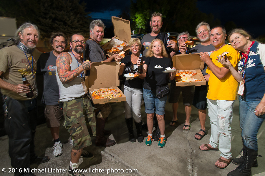 """Group photo for Robert """"Big Swede"""" Gustavsson (tall guy in the back!) at his parking lot Pizza Party with Chris and Pat Simmons, Scott and Sharon Jacobs, Dean """"Dino"""" Bordigioni (the host), mechanics and friends after stage 12 (299 m) of the Motorcycle Cannonball Cross-Country Endurance Run, which on this day ran from Springville, UT to Elko, NV, USA. Wednesday, September 17, 2014.  Photography ©2014 Michael Lichter."""