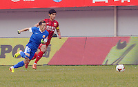 Bu Xin of Harbin Yiteng, front, breaks through Wang Shenchao of Shanghai East Asia during their 28th round match of the 2014 Chinese Football Association Super League in Harbin city, northeast China's Heilongjiang province, 19 October 2014.<br /> <br /> Harbin Yiteng drew with Shanghai East Asia 1-1.