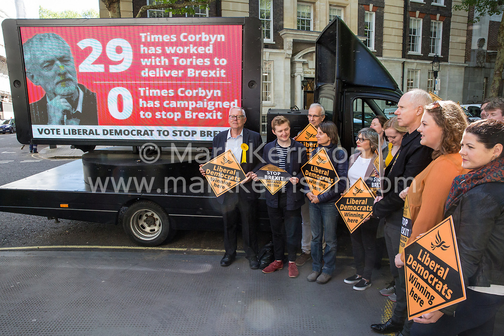 London, UK. 14 May, 2019. Liberal Democrat members prepare to launch a poster criticising Labour Party Leader Jeremy Corbyn's cooperation with the Conservative Party in attempting to deliver Brexit to be used as part of the Liberal Democrats' European election campaign.