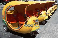 A row of Coco Taxis waiting for passengers near the Hotel Nacional; Vedado; Havana; Cuba,