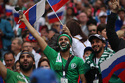 June 14, 2018 - Moscow, Russia - Russian Federation. Moscow. The Luzhniki Stadium. Match Opening of the World Cup 2018. Russia - Saudi Arabia. Solemn opening ceremony of the FIFA World Cup 2018. FIFA World Cup 2018. Player of the Russian national football team (in red).viewers; fans; (Credit Image: © face to face via ZUMA Press)