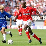 Charlton Athletic's Richard Rufus under pressure from Chelsea's Enrique De Lucas.