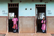 Congolese girls wait for school to commence at Pece School in Gulu, Uganda.