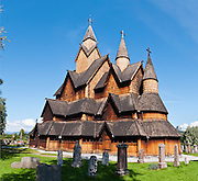 "Heddal stave church (stavkirke) is Norway's largest stave church. This triple nave stave church (which some call ""a Gothic cathedral in wood"") was built in the early 1200s and restored in 1849-1851 and the 1950s. Heddal stavkirke is in Notodden municipality, Telemark County, Norway. This image is a panorama stitched from 6 overlapping photos."