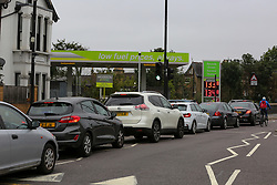 © Licensed to London News Pictures. 25/09/2021. London, UK. Motorists queue for over two hours for petrol at a petrol station in Bounds Green, north London as drivers continue to panic buy petrol amid a fuel shortage fear arising from a shortage of HGV drivers. Photo credit: Dinendra Haria/LNP