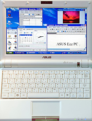 HANNOVER, GERMANY - MARCH-5-2008 - The much anticipated Asus 9 inch Eee PC was kept behind glass at the the CeBit technology convention, in Hannover, Germany, where visitors were lining up in droves to get some hands-on time with the sub-compact notebook. The 7 inch model was available for people to play with, but the new 9 inch model (actually 8.9 inches) was not available for the public to test drive. The 9-inch Eee PC should be available in mid 2008, and will be priced around ?399 for the 12GB version, but other capacities will be available. Details about US pricing are not yet available. (Photo © Jock Fistick)