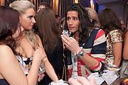 SERVING VODKA SHOTS TO OLLIE LOCKE; The London Bar and Club awards. Intercontinental Hotel. Park Lane, London. 6 June 2011. <br /> <br />  , -DO NOT ARCHIVE-© Copyright Photograph by Dafydd Jones. 248 Clapham Rd. London SW9 0PZ. Tel 0207 820 0771. www.dafjones.com.