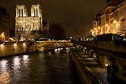Cathedral Notre Dame de Paris at night on Île de la Cité by  the river Seine, Paris, France