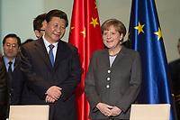 28 MAR 2014, BERLIN/GERMANY:<br /> Xi Jinping (L), Staatspraesident der Volksrepublik China, und Angela Merkel (R), CDU, Bundeskanzlerin, waehrend einer Unterzeichnungszeremonie verschiedener Politischer und Wirtschaftlicher Vereinbarungen, Bundeskanzleramt<br /> IMAGE: 20140328-01-005