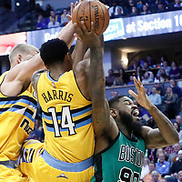 10 March 2017: Boston Celtics forward Amir Johnson (90) is fouled by Denver Nuggets guard Gary Harris (14) and Denver Nuggets center Mason Plumlee (24) during the Denver Nuggets 119-99 victory over the Boston Celtics, at the Pepsi Center, Denver, Colorado, USA.