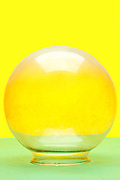 clear glass bowl object on yellow green background