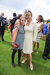 The COUNTESS OF MARCH and KINVARA and her daughter LADY ELOISE GORDON-LENNOX at the 3rd day of the 2011 Glorious Goodwood Racing Festival - Ladies Day at Goodwood Racecourse, West Sussex on 28th July 2011.