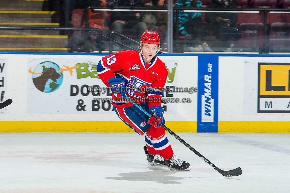 KELOWNA, BC - FEBRUARY 06:  Riley Woods #13 of the Spokane Chiefs skates with the puck against the Kelowna Rockets at Prospera Place on February 6, 2019 in Kelowna, Canada. (Photo by Marissa Baecker/Getty Images)