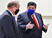 Illinois Governor J.B. Pritzker (right) talks with St. Clair County Board Chairman Mark Kern while on a tour of the mass vaccination site at the Belle-Clair Fairgrounds in Belleville, IL on February 18, 2021.<br />Photo by Tim Vizer