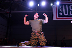 December 21, 2017 - Sevilla, Spain - A Marine shows off his muscles during a pushup challenge during the Chairman?'s USO Holiday Tour at Moon Air Base Dec. 21, 2017. Marine Corps Gen. Joe Dunford, chairman of the Joint Chiefs of Staff, and Command Sgt. Maj. John W. Troxell, senior enlisted advisor to the chairman of the Joint Chiefs of Staff, along with USO entertainers, visited service members who are deployed from home during the holidays at various locations across Europe and the Middle East. .(Credit Image: ? US Navy/ZUMA Wire/ZUMAPRESS.com)