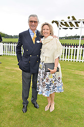 ARNAUD BAMBERGER and his wife CARLA at the Cartier Queen's Cup Final polo held at Guards Polo Club, Smith's Lawn, Windsor Great Park, Egham, Surrey on 15th June 2014.