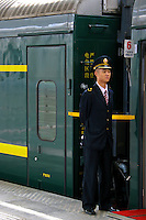 Conductor on the Tibet Train - The Qinghai-Tibet Railway, the highest rail line in the world, is usually called the Tibet Train.  Its 1,200 miles of tracks traverse 342 miles of permafrost, lots of it at altitudes exceeding 12,000 feet. The end of the line is Lhasa, Tibet. Proponents of the new railway say it will bring economic development to the Tibet and China's hinterlands as Tibet and China's far west lag behind the rest of the country, and rail connectivity promises to be a crucial tool for closing that gap.  Critics say the railway is  a political tool to strategically stitch Tibet into the fabric of China and facilitate the westward migration of ethnic Chinese.  The only thing about the train that everyone agrees on,  the the Tibet  train is an engineering marvel.