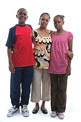 Portrait of a mother and teenage children in the studio,