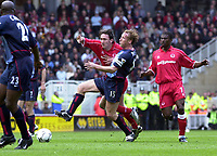 Photo: Greig Cowie<br />Middlesbrough v Arsenal. Barclaycard Premiership 19/04/2003<br />Ray Parlour and Jon Greening battle
