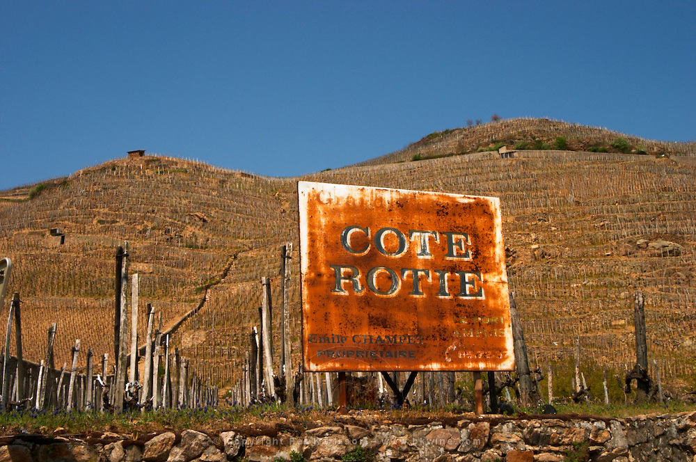 Rusty old sign saying Emile Champet, Cote Rotie. Terraced vineyards in the Cote Rotie district around Ampuis in northern Rhone planted with the Syrah grape. Ampuis, Cote Rotie, Rhone, France, Europe