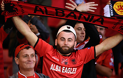 An Albania fan in the stand waves a scarfduring the UEFA Nations League, League C Group one match at Hampden park, Glasgow.