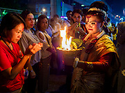 19 OCTOBER 2018 - BANGKOK, THAILAND: A woman blesses other women during Navratri observances in Bangkok. Navratri is a nine night (10 day) long Hindu celebration that marks the end of the monsoon and honors of the divine feminine Devi (Durga). The festival is celebrated differently in different parts of India, but the common theme is the battle and victory of Good over Evil based on a regionally famous epic or legend such as the Ramayana or the Devi Mahatmya. Navratri is celebrated throughout Southeast Asia in communities that have a large Hindu population.   PHOTO BY JACK KURTZ