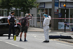 © Licensed to London News Pictures. 18/08/2020. London, UK. The crime scene around Jubilee Avenue in Chingford, East London after a man was stab near Highams Park railway station. Police were called shortly before 02:30hrs on Tuesday, 18 August following reports of a man with stab injuries. Prior to the arrival of London Ambulance Service, officers carried out first aid on the 18-year-old- man. He was taken to an east London hospital and his injuries are currently believed to be life threatening. The man is thought to have sustained his injuries during a fight with three other men near to the railway crossing. Photo credit: Dinendra Haria/LNP