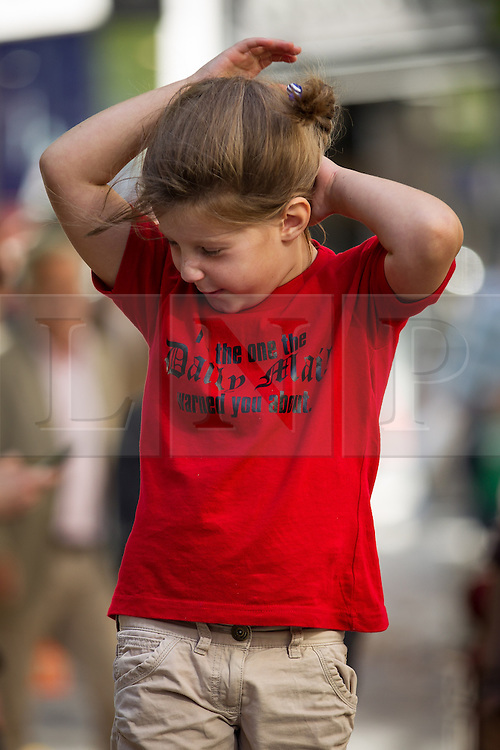 """© Licensed to London News Pictures . 06/10/2013 . Manchester , UK . A young girl wearing a t-shirt that reads """" I'm the one the Daily Mail warned you about """" . A demonstration against the Daily Mail newspaper in central Manchester's St Anne's Square today (6th October 2013) . Photo credit : Joel Goodman/LNP"""