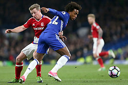 8 May 2017 - Premier League Football - Chelsea v Middlesbrough<br /> Grant Leadbitter of Boro grabs Willian of Chelsea around the waist as he chases the ball<br /> Photo: Charlotte Wilson
