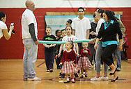 Middletown, New York - A young girl smiles for the camera after walking under the foam bar during a limbo contest at Family Night at the Middletown YMCA on April 2, 2011.