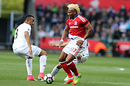Adama Traore of Middlesbrough ®  goes past Jordan Ayew of Swansea city (l). Premier league match, Swansea city v Middlesbrough at the Liberty Stadium in Swansea, South Wales on Sunday 2nd April 2017.<br /> pic by Andrew Orchard, Andrew Orchard sports photography.