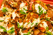 """Jamaica, NY - 20 July 2017. Business plan presentations of the second cohort of the 12-week Jamaica FEASTS program at the Queens Public Library. Vegan smashed potatoes with """"chorizo"""", """"mozzarella"""" and """"sour cream"""" by Geraldine Fermin are both vegan and gluten-free."""