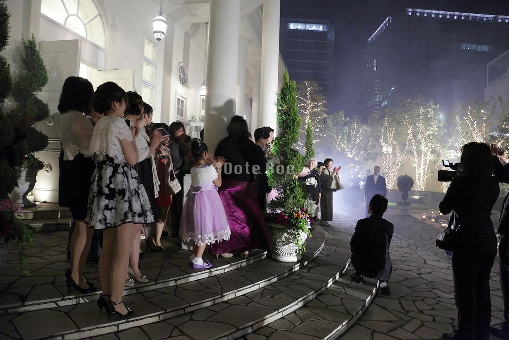 applause after fireworks at a wedding celebration Japan