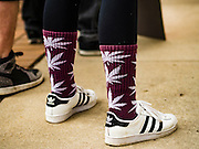 20 APRIL 2016 - ST. PAUL, MN: People wear socks with marijuana graphics on them during a rally for marijuana legalization in St. Paul. About 100 people gathered at the Minnesota State Capitol in St. Paul and marched through downtown St. Paul calling for the decriminalization of marijuana. April 20 (4/20) has become a sort of counter culture holiday in the US, with marches in many cities calling for the legalization of marijuana.      PHOTO BY JACK KURTZ