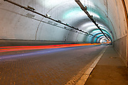 Long exposure of the inside of a artificially illuminated traffic tunnel tail light streaks can be seen