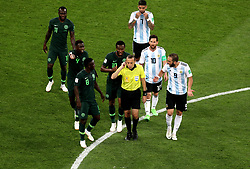 Players from both sides appeal to match referee Cuneyt Cakir after Nigeria claim Argentina's Marcos Rojo (not in picture) handled the ball during the FIFA World Cup Group D match at Saint Petersburg Stadium.