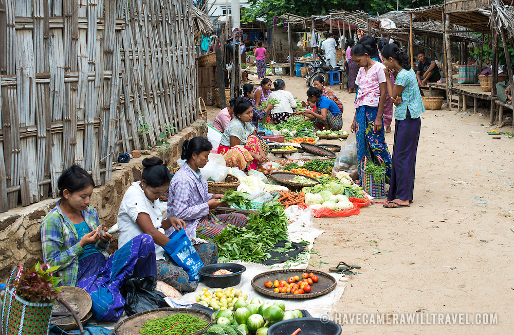 Local women selling their wares at the morning market in Myinkaba Village, a small local village that lies between Old Bagan and New Bagan in Myanmar.