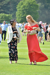 Left to right, BEATRIX ONG and OLIVIA INGE at The Royal Salute Coronation Cup Polo held at Guards Polo Club,  Smiths Lawn, Windsor Great Park, Egham on 23rd July 2016.