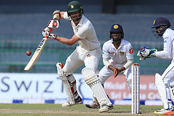 July 14, 2017 - Colombo, Sri Lanka - Zimbabwe cricketer Craig Ervine (L) plays a shot as Sri Lanka's Kusal Mendis(2R) and Niroshan Dickwella(R) look on  during the first day of the only Test cricket matcth between Sri Lanka and Zimbabwe at ..R Premadasa International Cricket Stadium,in the capital city, Colombo, ..Sri Lanka on Friday 14 th July 2017  (Credit Image: © Tharaka Basnayaka/NurPhoto via ZUMA Press)