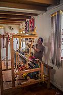 Jose Cotacachi, a famous weaver in Peguche, Ecuador at his loom.