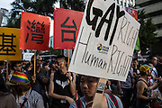 An advocate for equal marriage rights carries a sign during Taipei's pride festival.