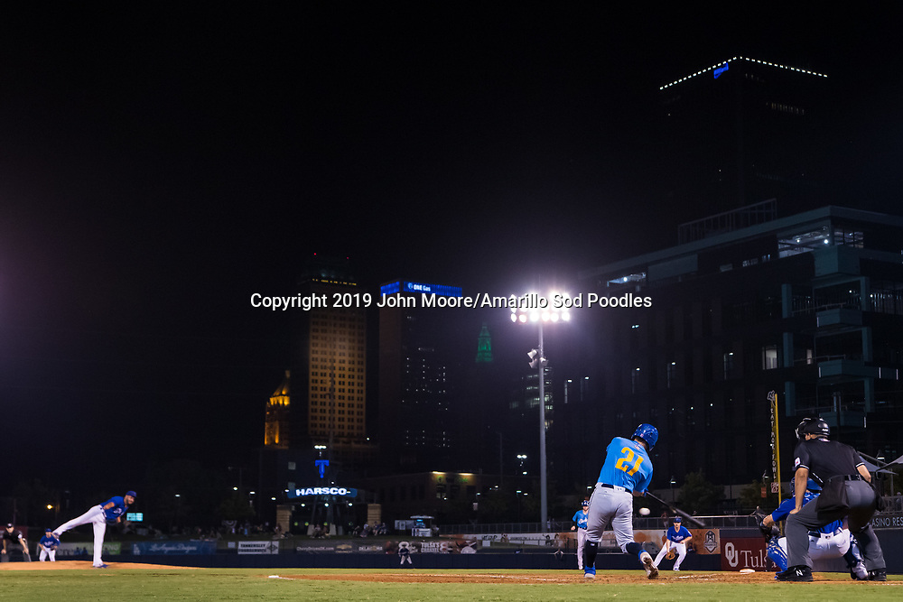 Amarillo Sod Poodles catcher Luis Torrens (21) hits the ball against the Tulsa Drillers during the Texas League Championship on Saturday, Sept. 14, 2019, at OneOK Field in Tulsa, Oklahoma. [Photo by John Moore/Amarillo Sod Poodles]